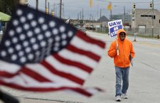 Rocky Perry, a 20-year General Motors employee, pickets outside the GM Fabrication Division, Wednesday, Oct. 16, 2019, in Parma, Ohio. Bargainers for GM and the United Auto Workers reached a tentative contract deal on Wednesday that could end a monthlong strike that brought the company's U.S. factories to a standstill. (AP Photo/Tony Dejak)